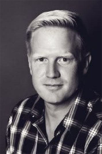 Image of man with blonde hair and checkered shirt